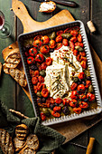 Baked feta with tomatoes, olives and rosemary