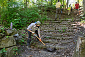Volunteers cleaning a park
