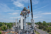 Workers upgrading a cell tower, aerial photograph