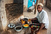 Man cooking, Lamu, Kenya