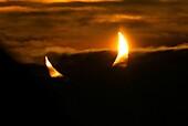 Partial solar eclipse at sunrise
