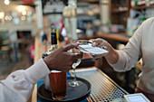 Bartender giving bill to customer in pub