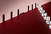 Line of dominoes, conceptual image