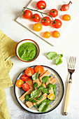Pizzoccheri with rocket pesto and tomatoes
