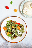 Green basil tagliatelle with burrata and tomatoes