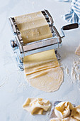 Roll out pasta dough with a pasta machine