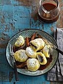 Potato dumplings with poppy seed stuffing and damsoncheese sauce