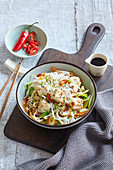 Rice noodles with fried tofu and sesame