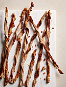Twisted pizza sticks made with tomatoes, cheese and herbs