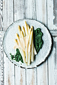 Asparagus with stinging nettle spinach and butter sauce