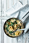 Cheese Knöpfle (soft egg noodles from Switzerland) with spinach and roast onions