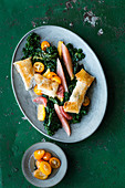 Kale salad with citrus fruit and cod in brik pastry