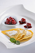 Poppy seed dumplings with cherry compote