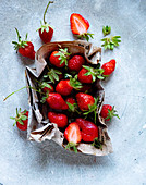 Fresh strawberries in a paper cup