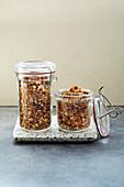Homemade pan-fried amaranth granola in storage jars