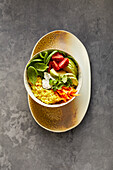 Vegan curry millet bowl with spinach