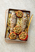 Oven trout with stuffed herb tomatoes