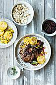 Wild boar steak with popcorn, a corn medley and blackberry sauce