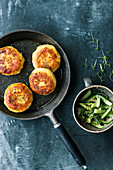 Trout and potato cakes with braised cucumber