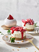 Mini cheesecakes with oven-baked rhubarb and raspberry coulis