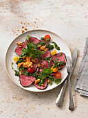 Fillet of beef with purslane and crumble crunch in a nutty herb sauce