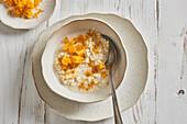 Almond-millet breakfast porridge with orange and honey