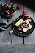 Hazelnut chocolate spread on a slice of brioche