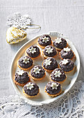 Lemon tartlets with poppy seed and dried plum filling