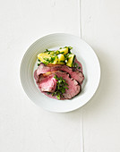 Roast beef with herb potatoes