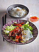 Vietnamese pork with sweet sour sauce and noodles