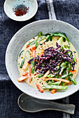 Coconut bean stew with sweet and sour sesame cabbage and ginger