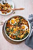 Pointed cabbage shakshuka with vegan 'egg' on tofu and pumpkin puree