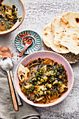 Cassava and green cabbage stew with black beans and soft tacos