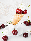 Ice cream cone with fresh cherries