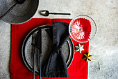 Red and black place settings
