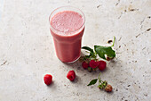 Vegan raspberry protein shake with soy milk