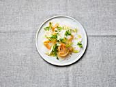 Radish carpaccio with smoked salmon and Parmesan cheese