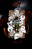 Christmas table with dirty plates and cups