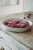 Lilac flowers in a bowl