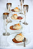 Dessert plates and champagne glasses on a wedding table