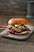 Burger with roasted venison fillet, kohlrabi and pumpernickel crunch