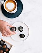 Chocolate bon bons with hand