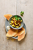 Thin rice cakes with pineapple and fig salad