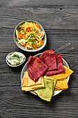 Colourful savoury crêpes with vegetables and curd dip