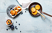 Quarkkeulchen (Potato and cheese dumplings) with apple-blueberry compote