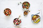 four healthy breakfast bowls - granola, muesli, and overnights
