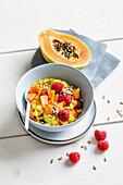 Millet-vanilla-porridge with turmeric and papaya