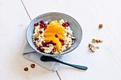 Vegan orange yogurt with oranges and pomegranate seeds
