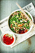 Fried rice with chicken, peas and sweet chilli sauce