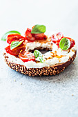 Breakfast bagel with feta and stewed tomatoes